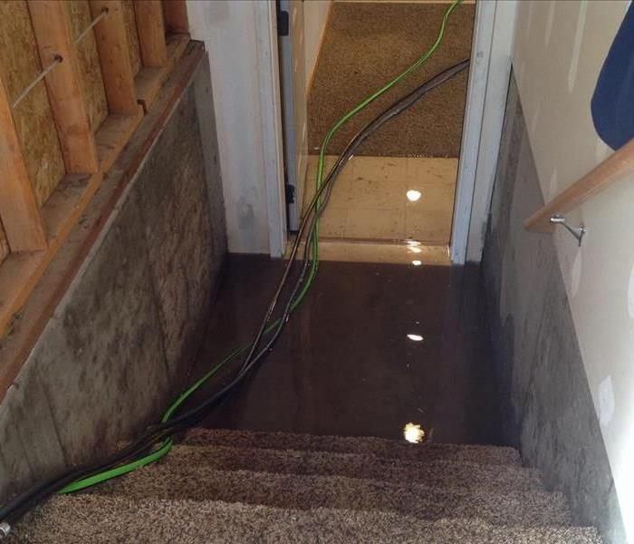 Water Damage Draining a Flooded Basement